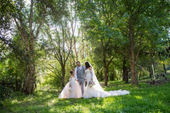 Photograph of Maitland bride paterson wedding. filtered light in green grove of trees