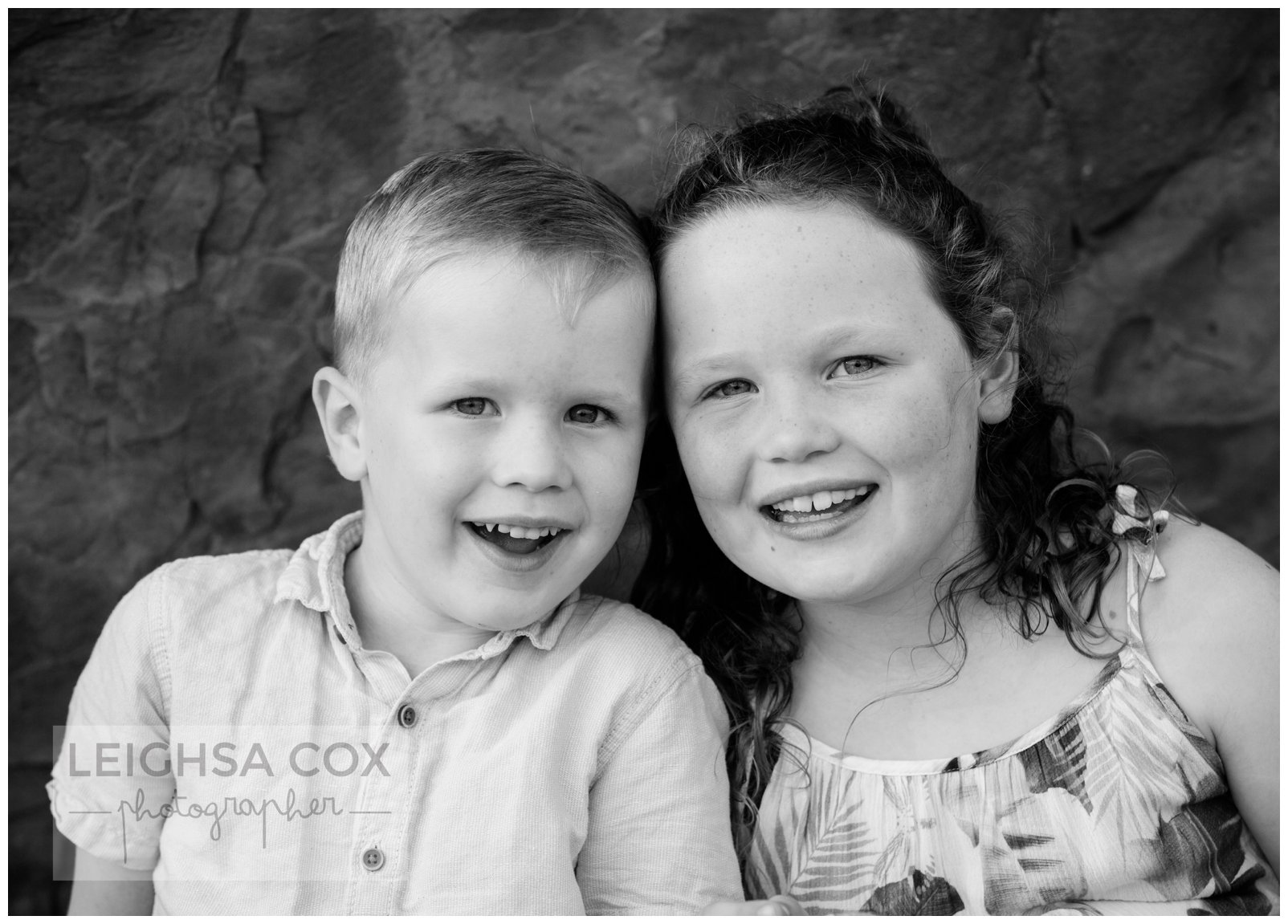 black and white sibling portrait