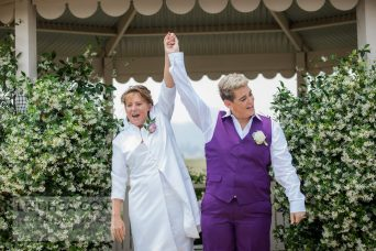 bride and bride announced at hunter valley wedding, huge smilies