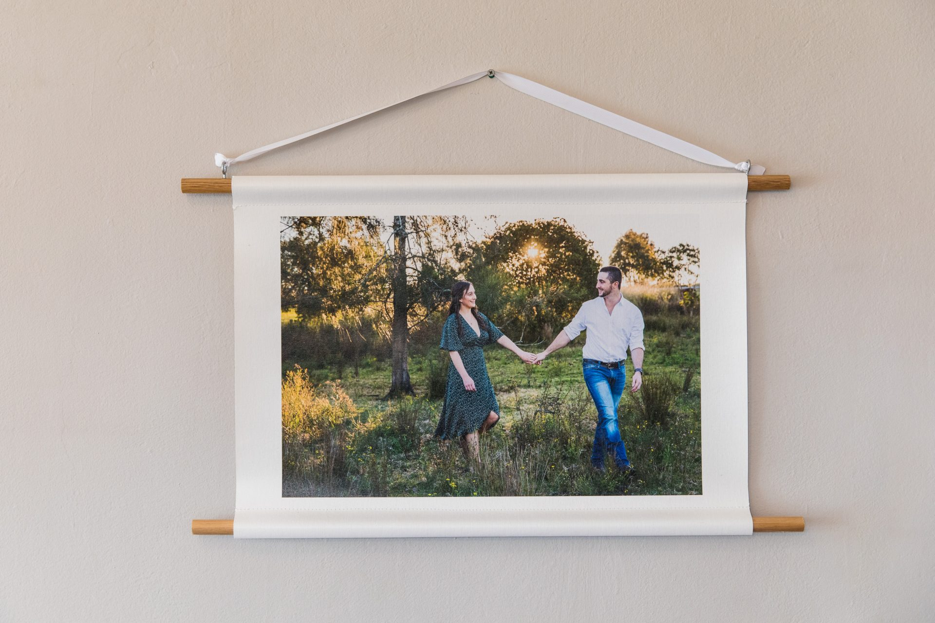 Beautiful canvas print. Bride and groom holding hands. Photographed by Newcastle and Hunter region wedding photographer.