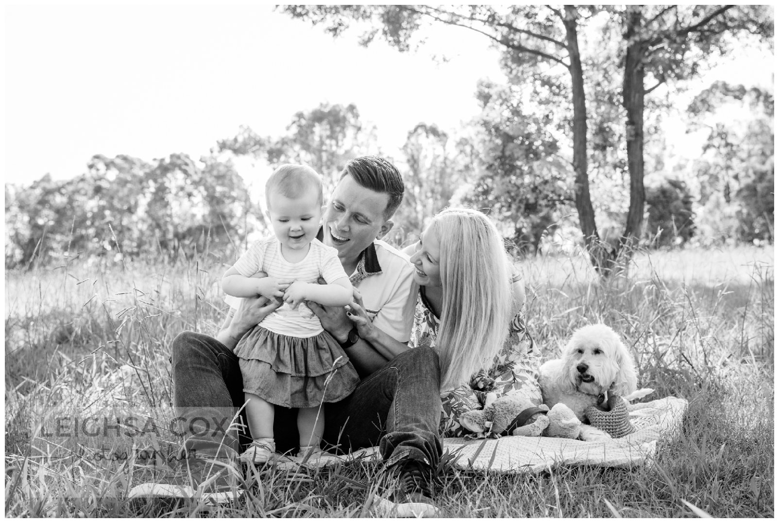 black and white family in park