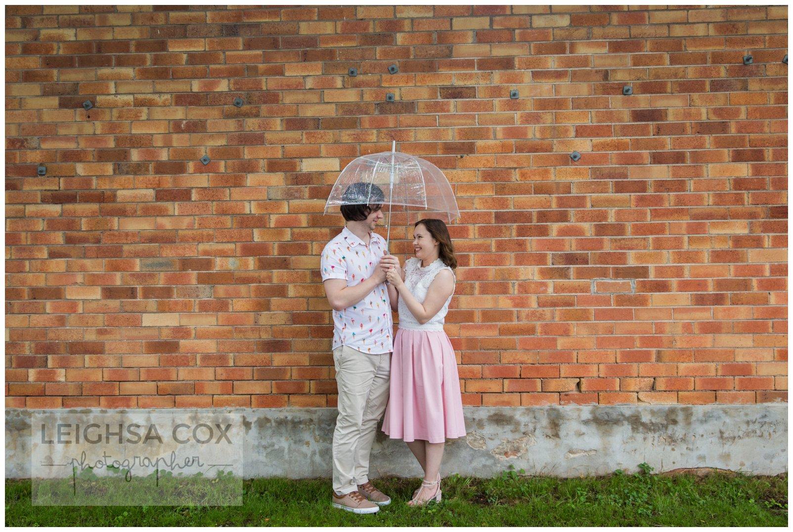 couple at Lorn in rain