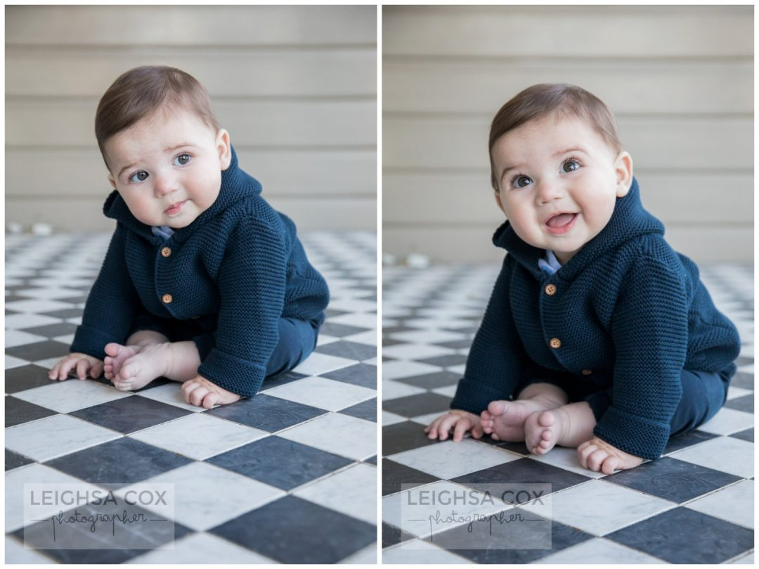 baby boy on checkered tiles