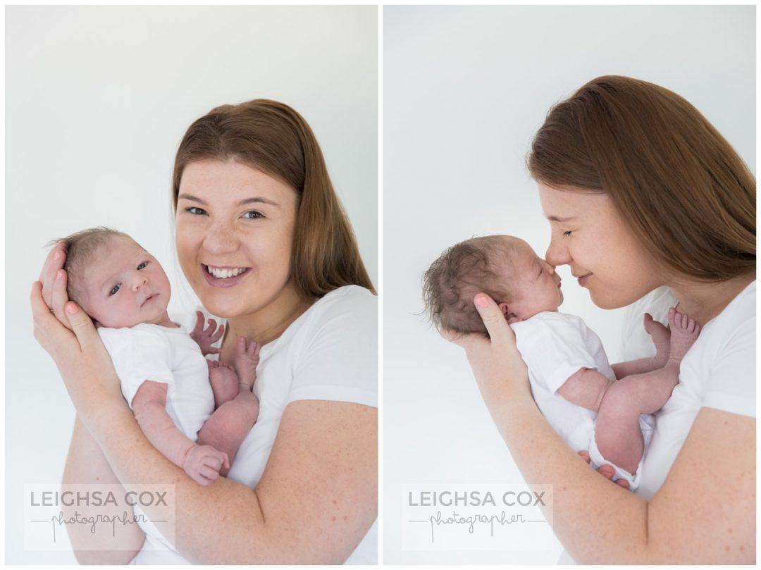 mum snuggles newborn